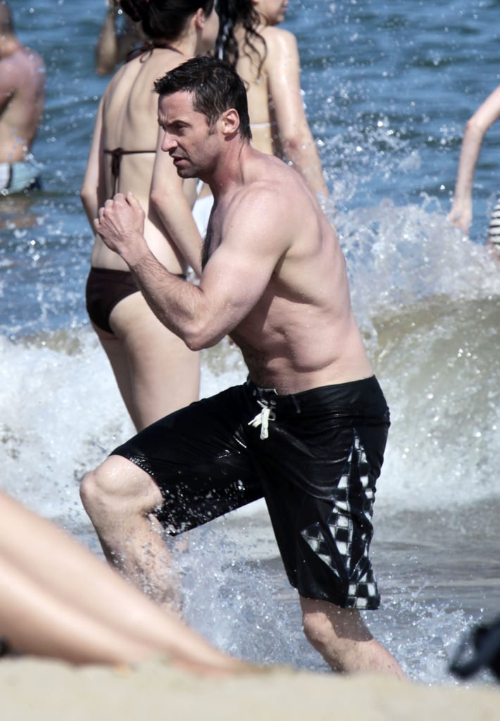 A shirtless Hugh Jackman jogged on the beach in Spain during a getaway in June 2012.