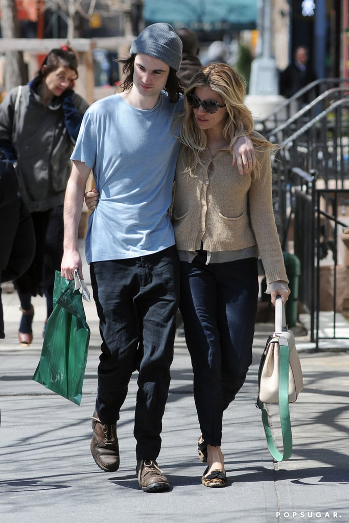 Tom Sturridge and Sienna Miller held onto their respective bags as they made their way through NYC on Wednesday.