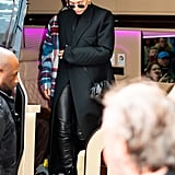 Hailey wore a black Bottega Veneta coat with leather leggings, patent leather boots, and a crossbody bag while out with husband Justin Bieber.