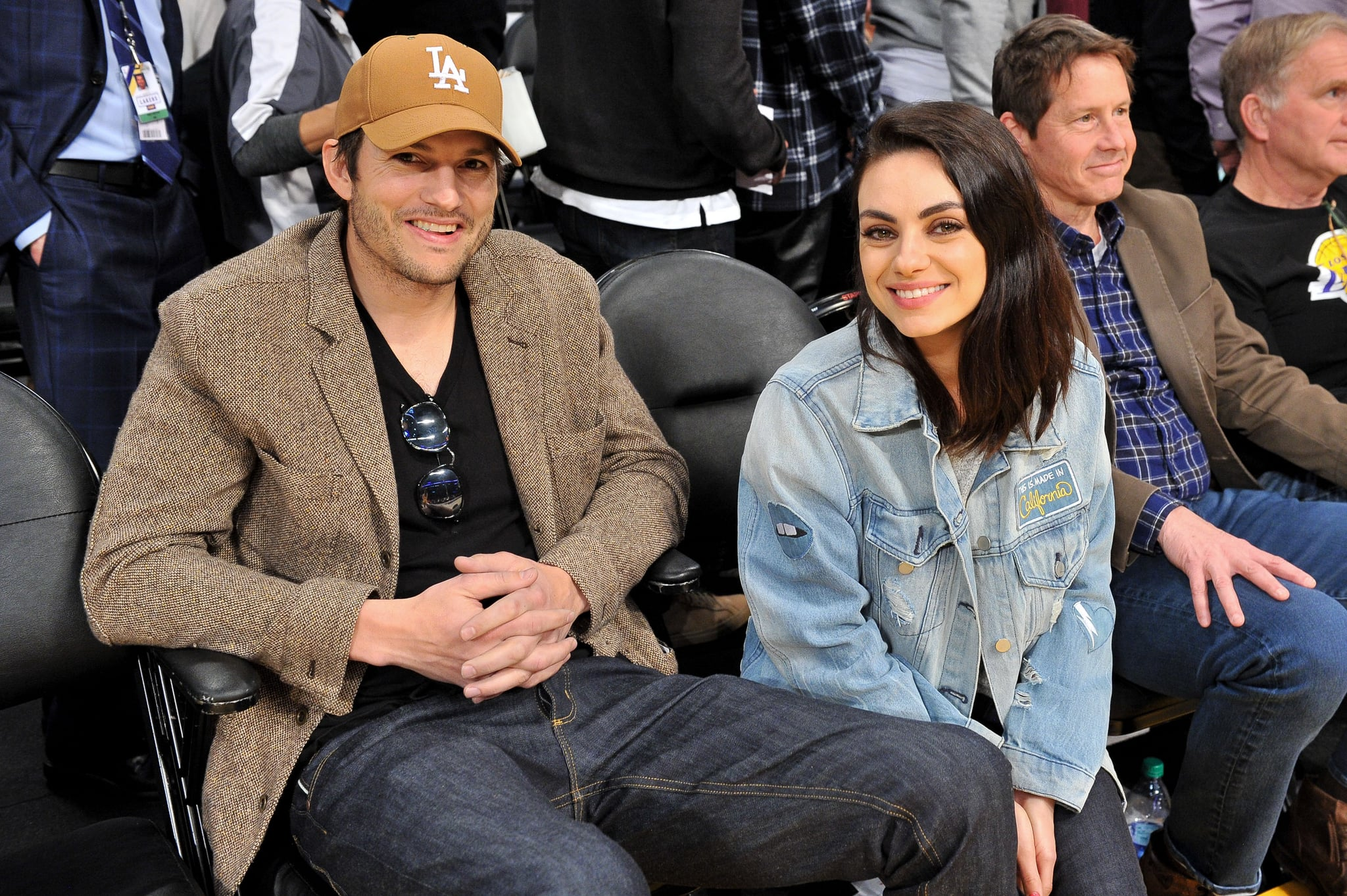 LOS ANGELES, CALIFORNIA - JANUARY 29: Ashton Kutcher and Mila Kunis attend a basketball game between the Los Angeles Lakers and the Philadelphia 76ers at Staples Centre on January 29, 2019 in Los Angeles, California. (Photo by Allen Berezovsky/Getty Images)