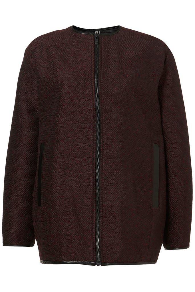 "Oxblood is the color of the season; the leather trim on this Topshop Premium Jacquard Bomber Coat ($250) makes it an easy ""must buy"" choice."
