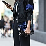 Match Your Bomber Jacket With a Velvet Bag
