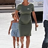 Halle put her adorable baby bump on display in a formfitting green t-shirt dress, then finished with gold flip-flops. If you, too, want to show off your figure, reach for a similar body-con silhouette.