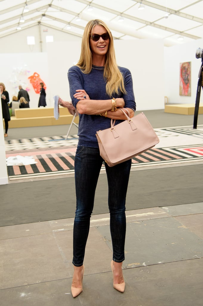 The supermodel can wear denim like no other. Check out those stems in skinny ankle jeans. Elle completed her casual-slash-dressy look with retro cat-eye shades, nude pumps, and a matching bag.       Pumps by Gianvito Rossi