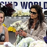 Pictures of Katie and Suri Buying Flowers and Chocolate