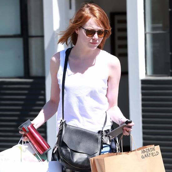 Emma Stone Carrying Bag With Andrew Garfield's Name