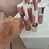 Fenty Beauty by Rihanna Gloss Bomb Universal Lip Luminizer Swatched on a Medium Skin Tone
