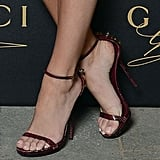 We love that she finished with slinky, sexy Gucci ankle-straps that add just a little intrigue with studded backs.
