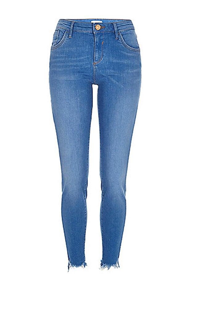 River Island Ripped Hem 'Amelie' Skinny Jeans ($84)