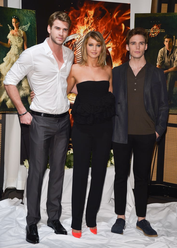 Liam Hemsworth, Jennifer Lawrence, and Sam Claflin attended a Catching Fire photocall.