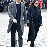 For a visit to Edinburgh, Scotland, Prince Harry wore a long grey coat, while Meghan chose a tartan Burberry number.