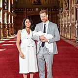 Meghan Markle Wearing a White Sleeveless Trench Dress For Baby Portraits at Windsor Castle
