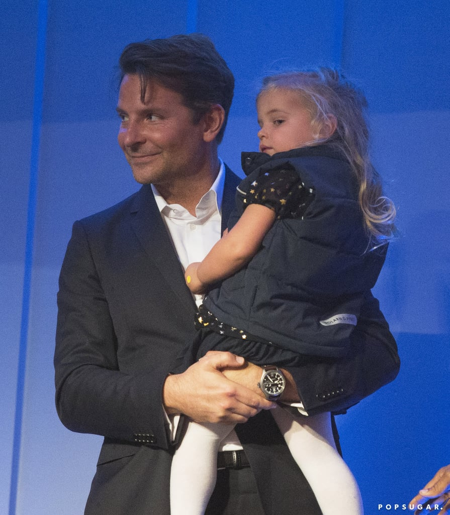 "At just 2 years old, Lea Cooper made her first public appearance when she accompanied her dad, Bradley Cooper, to the Mark Twain Prize Gala in Washington DC on Sunday evening. Lea, whom Bradley shares with ex Irina Shayk, looked adorable in a puffer vest and a black dress with silver stars, while the 44-year-old actor donned a black suit for the event. Bradley and Lea were on hand to support his A Star Is Born costar Dave Chappelle, who was honored with the American humor award.  ""He actually is a good friend of mine and I loved the experience of working with him,"" Dave said to Entertainment Tonight about Bradley. ""As far as my experience is concerned, Bradley is a consummate actor and director."" Bradley and Irina were together for four years before calling it quits this past June. They welcomed Lea into the world in March 2017, and even though they are no longer together, they're committed to coparenting her.       Related:                                                                                                           35 Pictures of Bradley Cooper's Blue Eyes That Will Stop You in Your Tracks"
