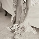 15. Bride Putting On Shoes