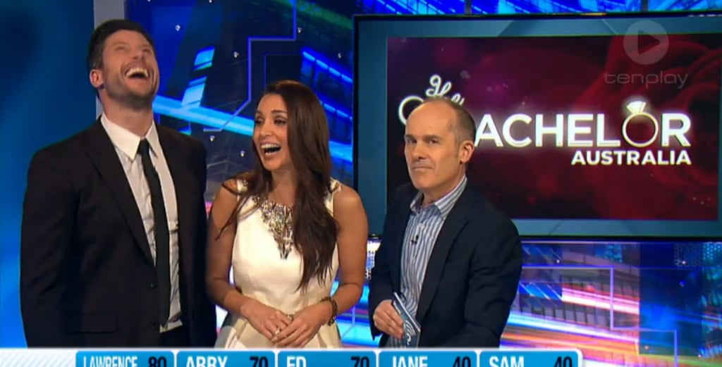 """Sam Wood and Snezana Markoski continued their promo tour of love with an appearance on Monday night's episode of Have You Been Paying Attention?. The hilarious quiz show, which recaps the week in news stories (pop culture, sport, politics and more) with the help of host Tom Gleisner and five hilarious panellists, has featured eliminated bachelorettes as guest quiz masters during the run of The Bachelor, so it made perfect sense for Sam and Snezana to ask the tough Bachelor-related questions now the show is over. The nature of HYBPA is that it pokes fun and is an irreverent take on the news, which is something Sam prepared himself for when he posted a picture on Instagram with the caption, """"The serious face before the laughs on #haveyoubeenpayingattention. Sure, the jokes were at my expense but these guys are seriously funny and can't wait to see tonight."""" Well, the panellists — regulars Ed Kavalee and Sam Pang, along with Jane Kennedy, Abby Coleman and Laurence Mooney — definitely laid down the jokes, and we've rounded up the most hilarious ones right here. Luckily Sam and Snez have a good sense of humour — as you can see from the screenshots, they couldn't stop laughing! Still obsessed with The Bachelor? Good, we are too! Get all that content here, and then be sure to follow us on Facebook, Twitter and Instagram for more."""