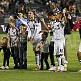 David, Cruz, Brooklyn, and Romeo Beckham waved to fans after a soccer game in LA.