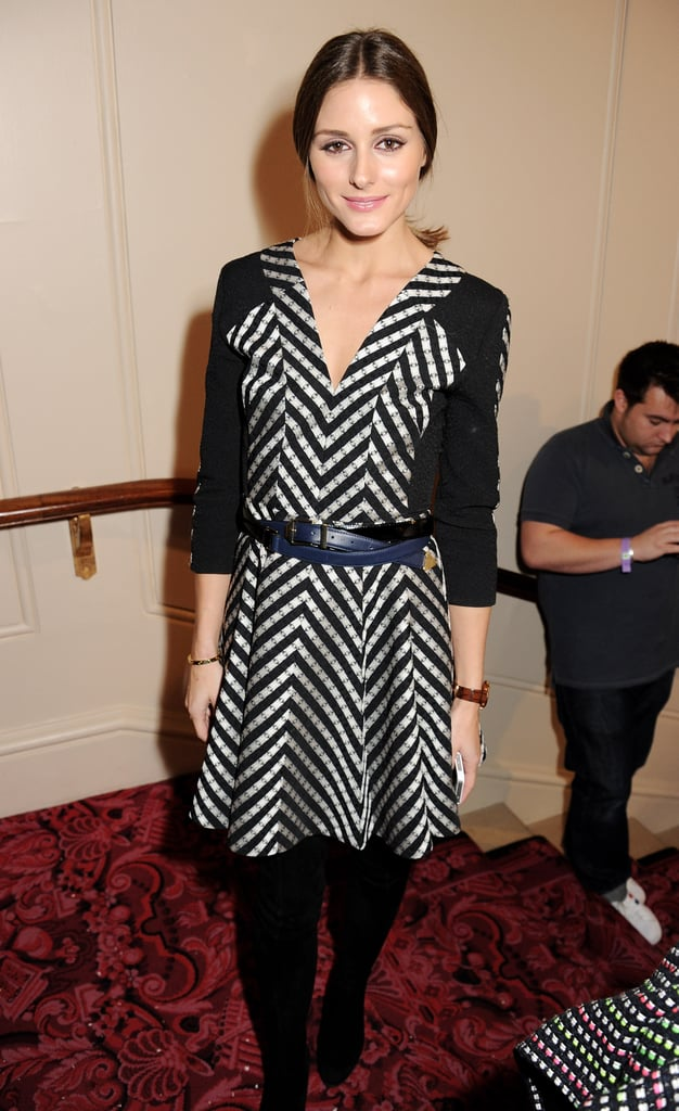 Olivia Palermo cinched her black-and-white printed dress with a navy belt while backstage at Matthew Williamson.