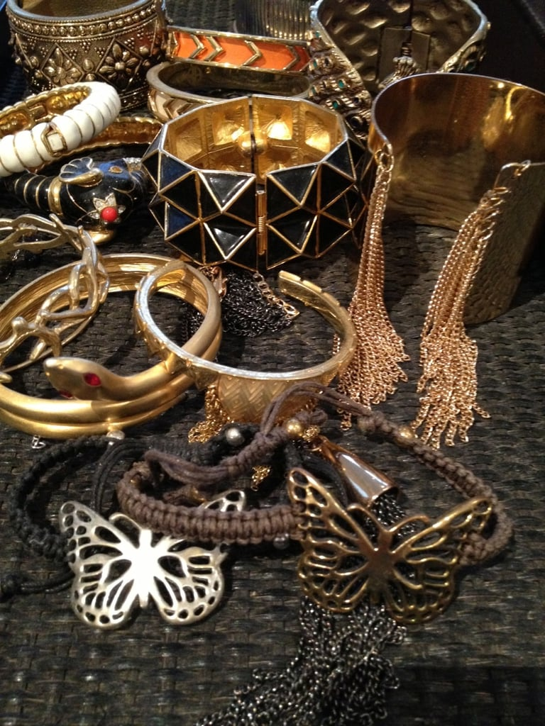 My bangle, bracelet and cuff collection displayed on a large rattan tray.