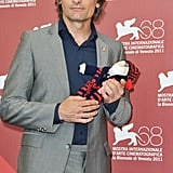 Viggo Mortensen with a stuffed animal.
