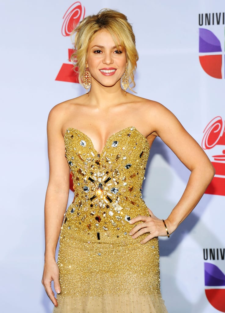 Shakira in a sparkling gold dress.