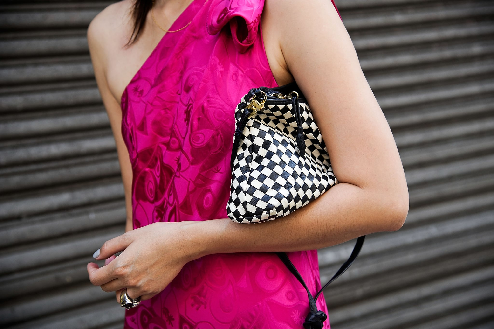 A vintage Bottega Venetta clutch popped against a pretty fuchsia dress.