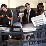 Kate Beckinsale, Len Wiseman, and Lily Sheen got ready to go through security.