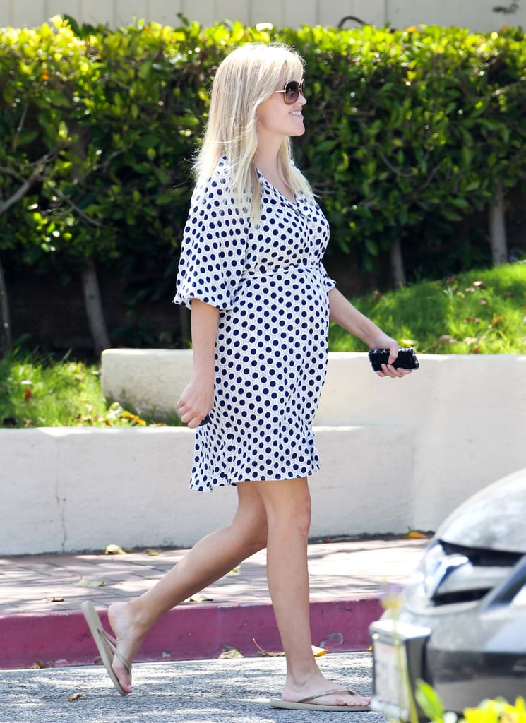 Reese Witherspoon sported a polka-dot dress while picking her kids up from school in LA.