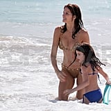 Stephanie Seymour and Lily ran in the waves.