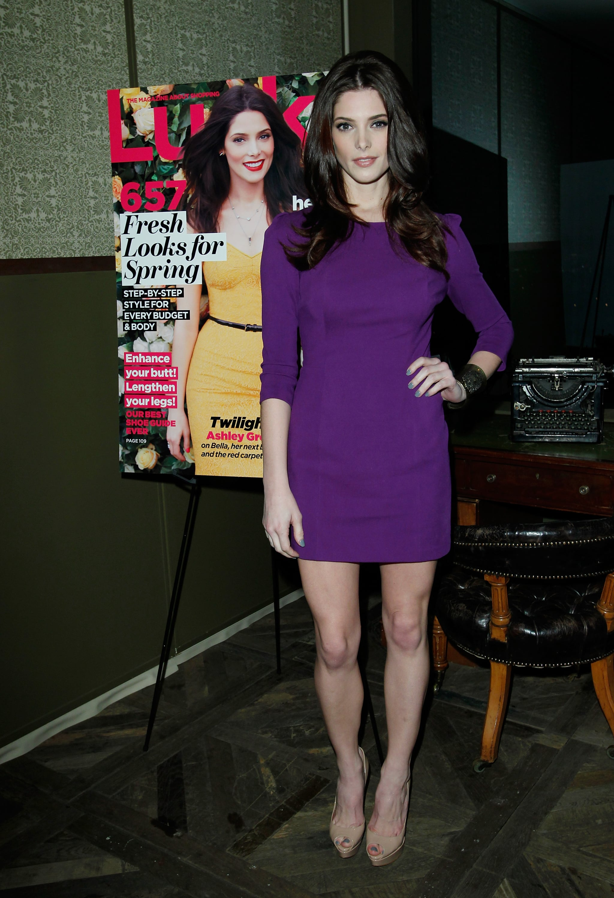 Celebrating her Lucky cover in a brilliant purple DKNY minidress in 2012.