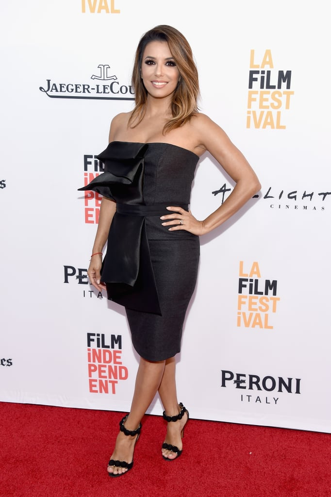 """Eva Longoria turned heads when she popped at the LA premiere of her latest project, Lowriders, on Wednesday. Clad in a strapless black dress, the star — who recently returned from her honeymoon — nearly lit up the red carpet with her newlywed glow and bright smile. While Eva attended the event solo, the outing marks the actress's first public appearance since tying the knot with Televisa president José Antonio Bastón in Mexico. Since then, she's been active on Instagram, sharing a handful of photos from her nuptials, as has pal Mario Lopez, who uploaded two amazing clips of Victoria and David Beckham busting a move to Rick Astley's '80s hit """"Never Gonna Give You Up."""" See more of Eva's night out, then relive her big day with these beautiful wedding pictures."""