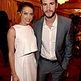 Paranoia costars Amber Heard and Liam Hemsworth posed together inside the event.