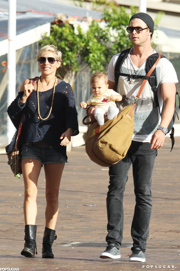 Chris Hemsworth and Elsa Pataky took a walk with their baby daughter India around the Circular Quay in Sydney, Australia, on Monday. Chris held the 9 month old as the family made their way through the promenade, and stopped to check out a few shops along the way. Chris and Elsa are currently Down Under after spending the weekend in LA, where they checked into a Santa Monica hotel. Chris is enjoying his downtime with loved ones before embarking on a new project with Michael Mann. He recently signed on to star in the director's upcoming crime thriller, which revolves around cyber threats and attacks. Chris will also be hitting the red carpet when it comes time to promote the Formula One racing flick Rush and Thor: The Dark World later this year.