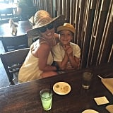 Britney held Jayden tight and smiled during a mom-and-son lunch in June 2015.