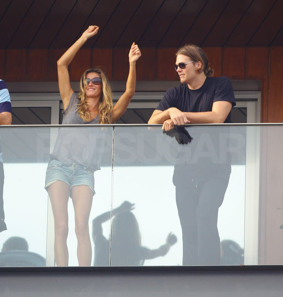 Gisele Bundchen and Tom Brady checked out the Carnival crowd from the balcony of their hotel in Rio de Janeiro yesterday. Gisele danced, sipped on a fruit cocktail, and shared a little PDA with her husband, who was sporting a ponytail to hold back his long hair. The couple arrived in Gisele's native Brazil over the weekend and got the party started at a sexy parade where Gisele showed off her samba moves on a float. Tom's been taking it easy since he's nursing a foot injury, but that shouldn't stop him from possibly lounging poolside during another one of Gisele's hot bikini escapades. She's a little more covered up though, in her latest ads for H&M, which have her sporting '70s inspired looks. LOTS more hot pictures of the partying couple when you click into the gallery!