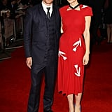 Michael suited up while Carey opted for a bright red dress.