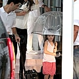 Katie Holmes and Suri Cruise stayed dry in the middle of the storm.