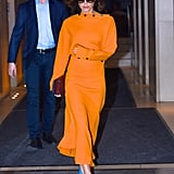 Victoria Beckham Wore a Button-Detailed Boatneck Dress With Her Signature Pumps