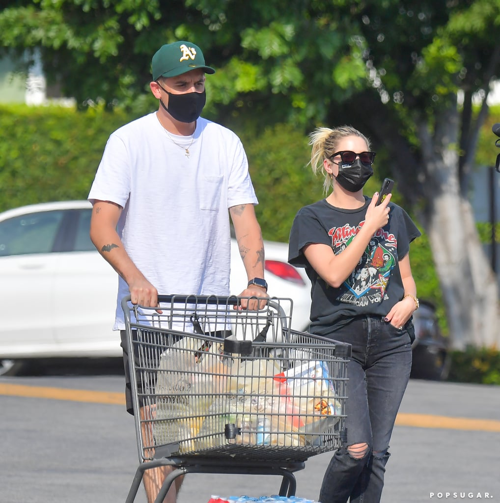 """Ashley Benson and G-Eazy are sparking engagement rumors after the 30-year-old actress was spotted sporting a diamond ring on that finger while grocery shopping with the 31-year-old rapper in LA on Tuesday. In the photos, we catch a glimpse of the shiny bauble as Ashley places her hand in one of her pockets. It's unclear if the ring is actually an engagement ring or just one of Ashley's many rings, but we doubt we'll find out anytime soon, given how private the couple are about their relationship.  Ashley and G-Eazy were first linked together in May following Ashley's split from Cara Delevingne. Though the pair have yet to officially confirm their relationship, they've shown PDA on multiple outings together and it's rumored that G-Eazy's song """"All the Things You're Searching For"""" is about Ashley. They also collaborated on a cover of Radiohead's """"Creep"""" in April. However, they have yet to post any photos together on social media. We guess only time will tell with this one.      Related:                                                                                                           All the Incredibly Good-Looking People Ashley Benson Has Dated"""