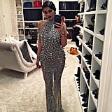 """Kylie snapped a photo of her bedazzled high-neck dress that featured a sheer train, writing, """"hello 1920."""" Her Yousef Al-Jasmi design featured Swarovski beads and over 400,000 crystals and is valued at $18,000 — no wonder it took 16 days to make!"""