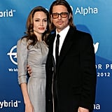 Angelina Jolie and Brad Pitt cuddled close on the red carpet at Cinema for Peace.