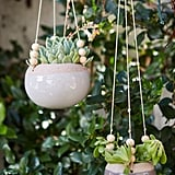 Small details like ceramic hanging planters are the difference between a decorated space and a warm, welcoming space.