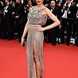 Freida Pinto flashed a little leg — and showed off a Swarovski crystal and pearl clutch that completed her shimmering, embellished gown — at the Jeune & Jolie premiere.