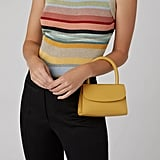 by FAR Mini Patent-Leather Top Handle Bag