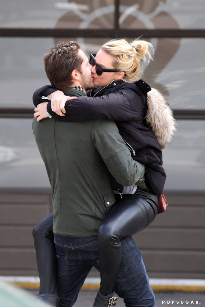 Margot Robbie and Tom Ackerley kissing publicly