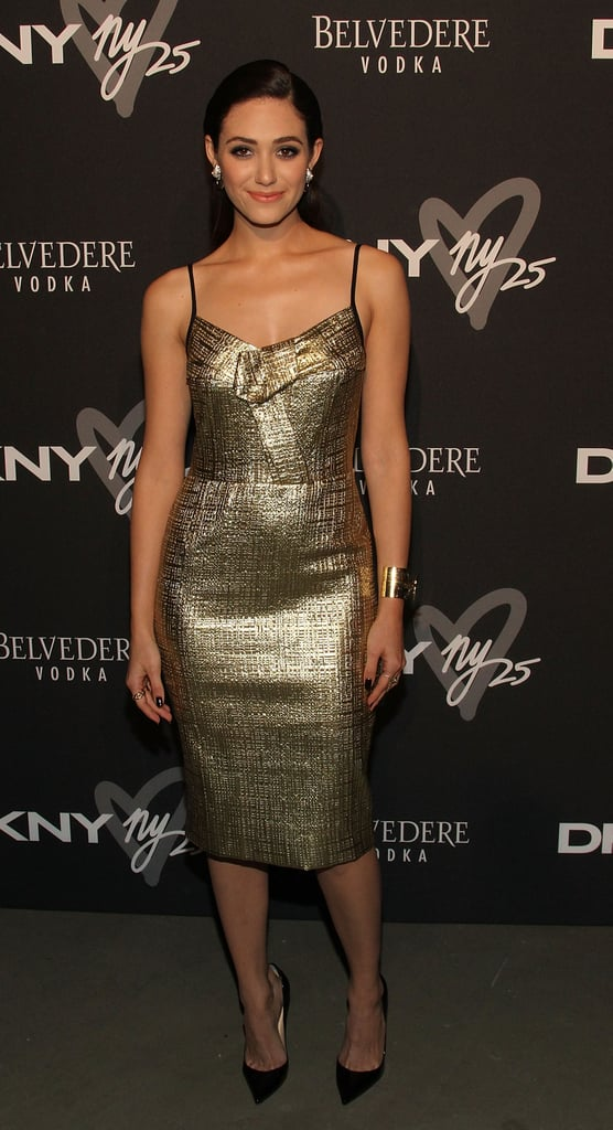 Emmy Rossum was golden in a formfitting dress and a matching gold cuff at the DKNY Birthday Bash during New York Fashion Week.