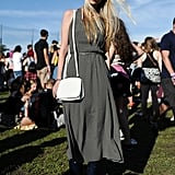 For this look, a fun belted dress was paired with practical rain boots, the perfect choice for a muddy day in the grass.