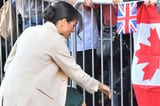 Meghan Markle s Latest Royal Visit Brought Back Her Messy Bun With a Ballerina Twist
