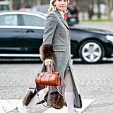 With a Grey Coat, Faux-Fur Accents, and Long Socks
