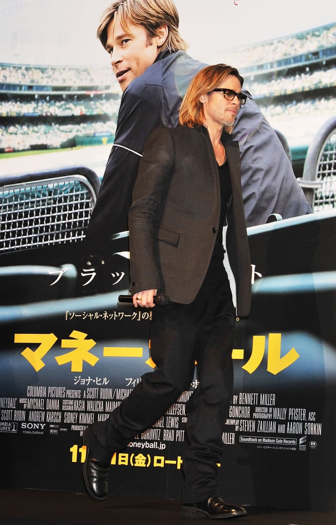 Brad Pitt walked in front of a poster of himself in Tokyo.