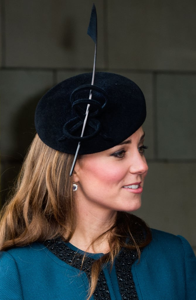 At a celebration for the London Underground in 2013, Kate wore a dark velvet headpiece accented with a single feather.